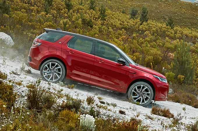 Auto Stahl der neue Discovery Sport 2019 Offroad Bergab Rot Seitenansicht
