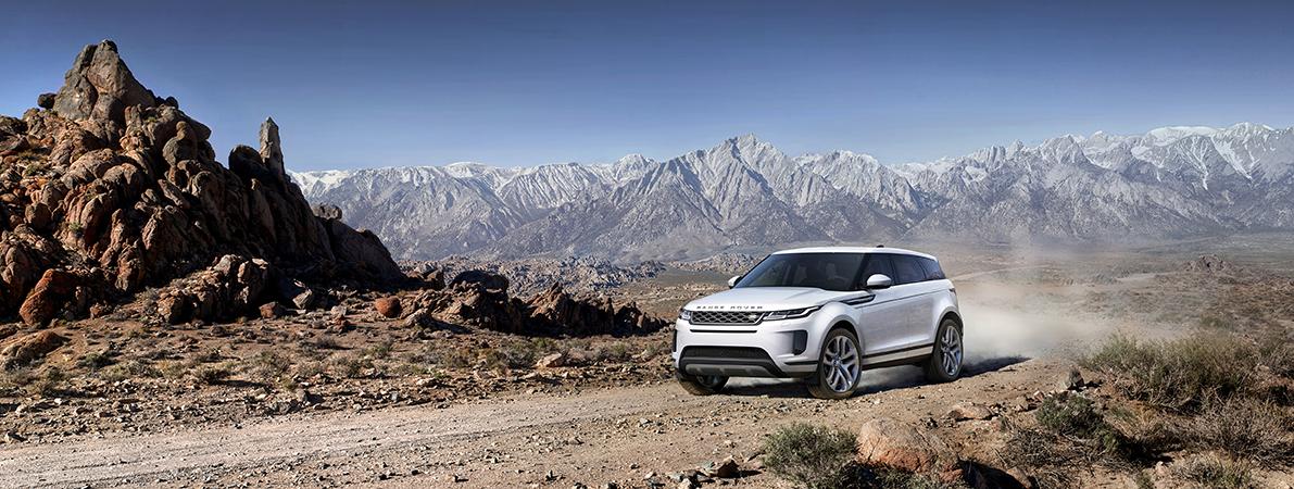 Range Rover Evoque 2019 Seitenansicht Steine Berge Natur Weiß