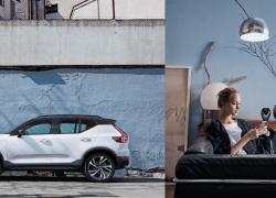 Volvo XC40, urbane Umgebung, Modellfarbe weiß mit junger Frau